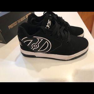 Brand new size 3 Heelys. Son wore them 30mins